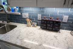 Blue backsplash to match paint